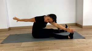 fase flexión the Saw, ejercicio de Pilates Mat